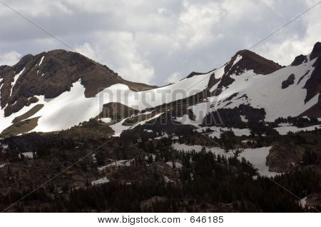 Sierra Mountains With Snow And Clouds