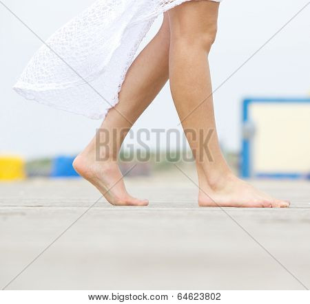 Young Woman Walking Barefoot Outdoors