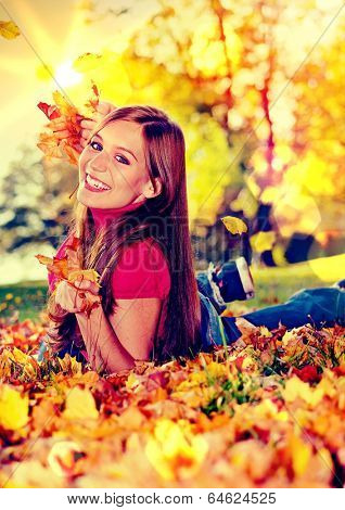 cute pretty girl in an autumn-park