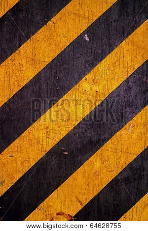 Black and yellow caution warning hazard stripes patten background