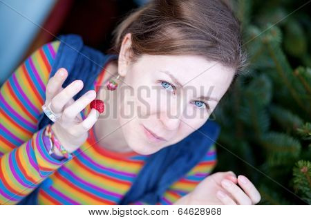 Beautiful Young Girl In Bright Clothes With Raspberry
