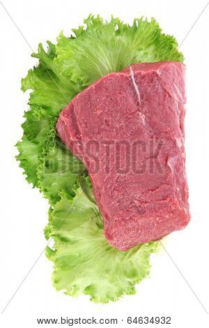 Raw beef meat with lettuce isolated on white