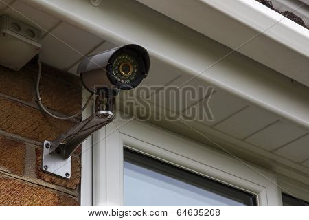 CCTV security camera mounted on house wall.
