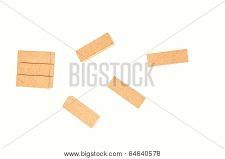 jenga tower colapsing on white background