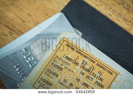 Passport Stamp Visa Of Japan And Credit Card For Travel Concept