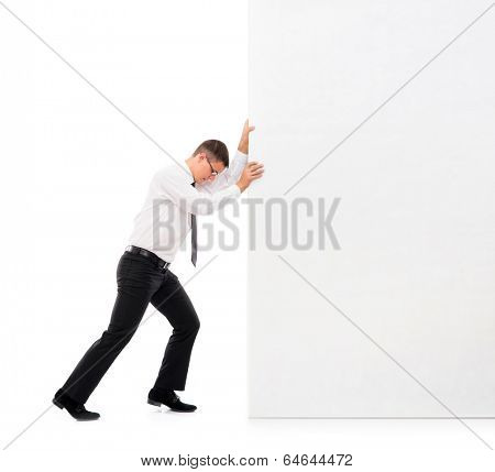 Business man pushing a big blank banner over white background