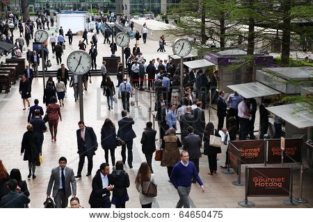 LONDON, UK - APRIL 24, 2014: Clock square of Canary Wharf business aria  and office workers