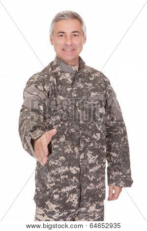 Mature Soldier Extending Hand To Shake
