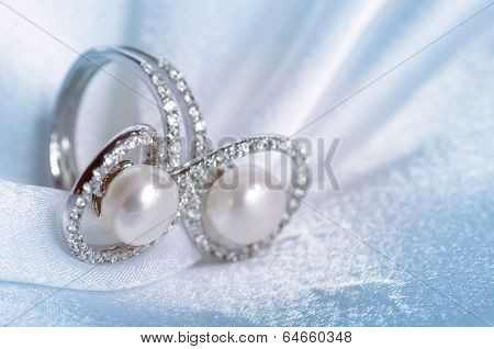 Jewelry ring on the fabric background closeup