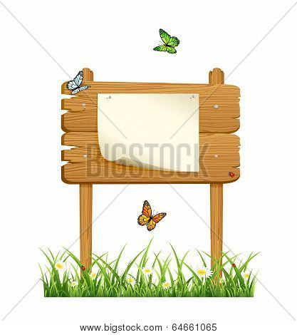 Wooden sign in grass with paper