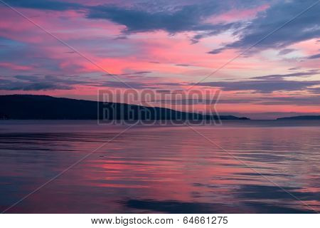 Scenic background of a pink and blue sunset on a cloudy overcast evening
