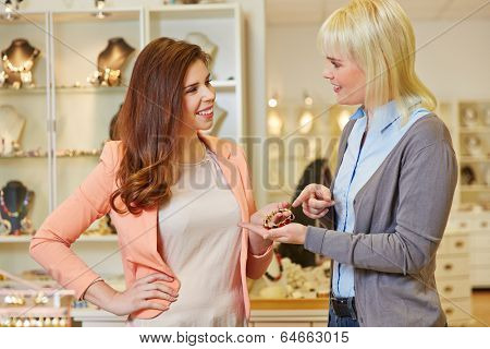 Personal Shopper with woman at jeweler buying jewelry