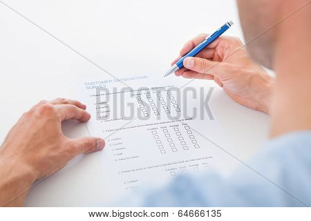 Person Filling Blank Form