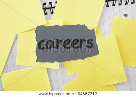 The word careers against sticky notes strewn over notepad