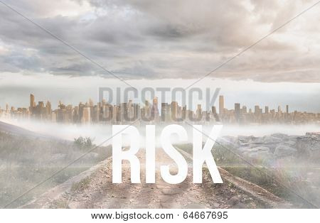 The word risk against stony path leading to large urban sprawl