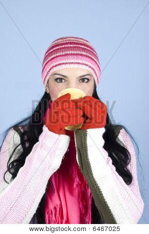 Woman Drinking Hot Drink In Winter Season
