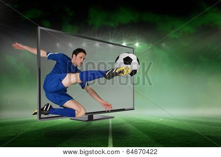 Composite image of fit football player kicking ball through tv against football pitch under green sky