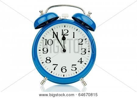a blue alarm clock on white background. five to twelve