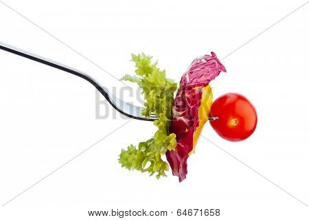 salad and vegetables on a fork. healthy diet with organic food