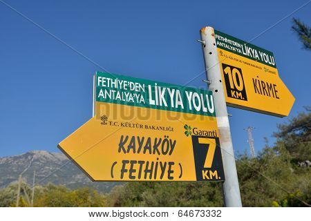 OLUDENIZ, TURKEY - MARCH 30, 2014: Sign on the Lycian Way near Oludeniz, Fethiye district of Mugla province. This long-distance footpath is listed as one of the world's top ten walks