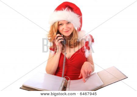 Miss Santa Is Taking Orders On The Phone