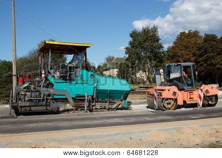 A couple of asphalt paving machines
