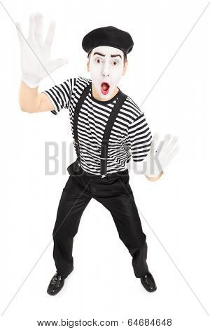 Male actor mimicking with hands isolated on white background