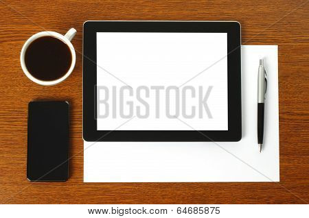 Tablet PC smart phone paper pen and cup of coffee
