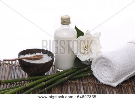Gardenia with towel and bamboo grove ,salt in bowl on mat