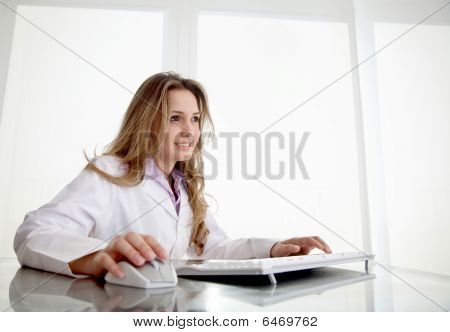 Female Doctor With A Computer