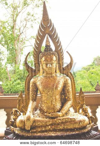 The Buddha statue with gold leaf.