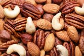 foto of mixed nut  - Background texture of assorted mixed nuts including cashew nuts - JPG