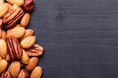 picture of pecan  - Background texture of assorted mixed nuts including cashew nuts - JPG