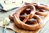 image of pretzels  - Selective focus on the front fresh baked Bavarian pretzel - JPG