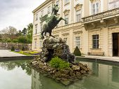 stock photo of metal sculpture  - Horse metal fountain sculpture surrounded by a pond - JPG