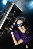 image of rap-girl  - Portrait of a modern girl with tape recorder over grunge background - JPG