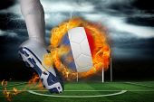 image of football pitch  - Football player kicking flaming france flag ball against football pitch under stormy sky - JPG