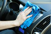 stock photo of detergent  - Hand with microfiber cloth polishing car - JPG