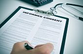 foto of pediatrics  - patient signing an informed consent in a doctors office - JPG