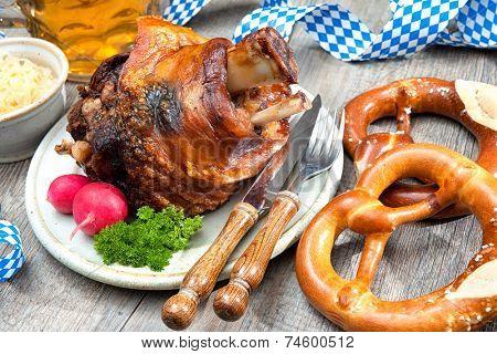 Schweinshaxe (German Pork Knuckle) with pickled cabbage and pretzel