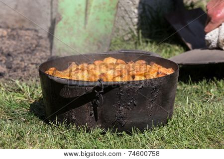 Traditional ushant island stewed potatoes, cooked under the soil, with golden potatoes, Brittany, France