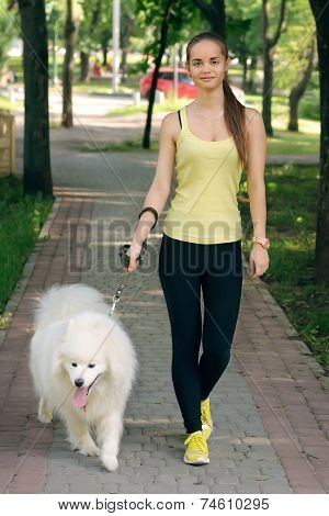 Girl With A Dog For A Walk