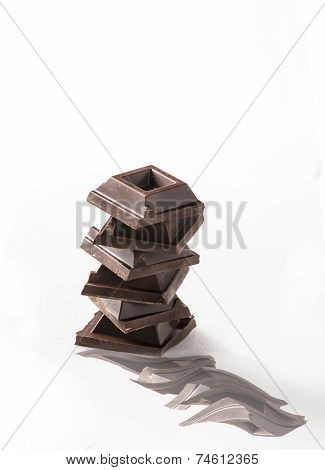 squares of chocolate on white background