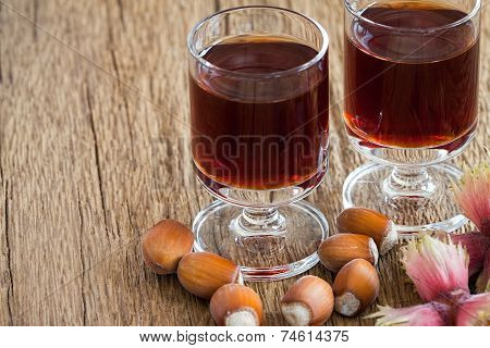 Hazelnut Liqueur In Two Glasses And Hazelnuts