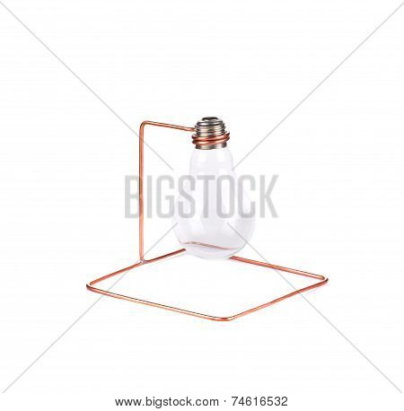 Light bulb suspended on metal wire.