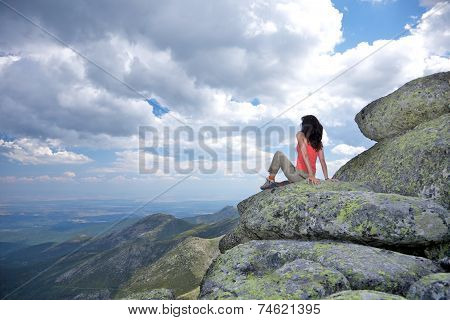 Woman Looking Cloudscape