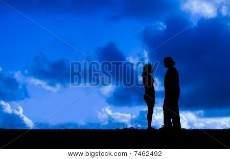 Blue cloudy sky & Romantic Couple