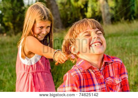 Seven Year Old girl Pooling Her Friends Hair