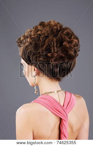 Frizzy Hair. Rear View Of Brown Hair Woman With Festive Hairstyle