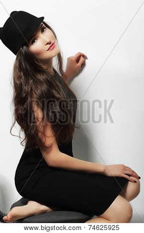 Authentic Woman In Black Dress And Woolen Cap